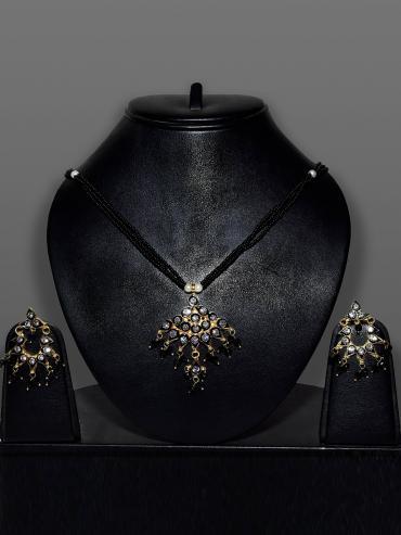 Awadhi Kundan Handmade High Quality Brass Golden Polish Pendant Set With Meenakari Work In Black